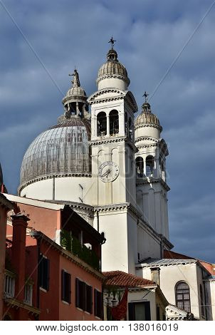 Santa Maria della Salute (St Mary of the Health) apse and belfries with cloudy sky in Venice