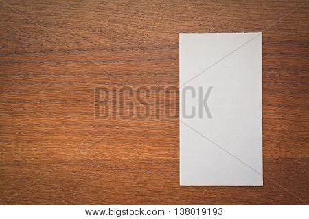 blank clean check on the wooden table