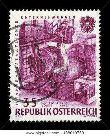 ZAGREB, CROATIA - SEPTEMBER 09: A stamp printed in Austria, devoted to 15th anniversary of nationalized industry, Pouring steel, VOEST, Linz, circa 1961, on September 09, 2014, Zagreb, Croatia