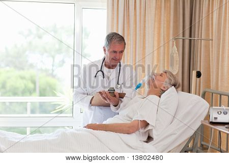 Doctor examining his patient