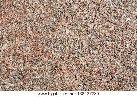Brown granite texture. Natural unpolished stone wall with grain surface, abstract background