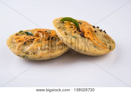 south indian favourite food rava idli or semolina idly or rava idly, served with sambar and green chutney