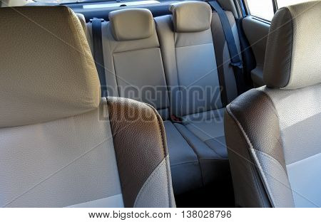 Car interior with bright leather upholstery on the car seats stock image