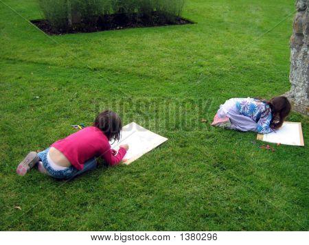 Girls Focusing In Drawing