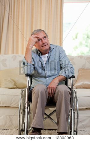 Senior man in his wheelchair at home