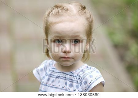 Portrait of a little girl on the road in park