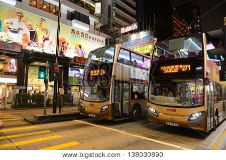 HONG KONG - NOV 9: Double deck buses stoped at intersection of Nathan Road and Austin Road at night on Nov 9, 2015 in Kowloon, Hong Kong. Nathan Road is a main commercial thoroughfare in Kowloon.