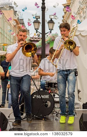 Moscow, Russia - July 10, 2016: Cover Band Brevis Brass Band Performance On A City Street. It Is Uni