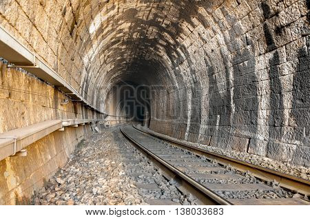 railroad tracks and old tunnel interior in dalmatian hinterland near labin dalmatia croatia