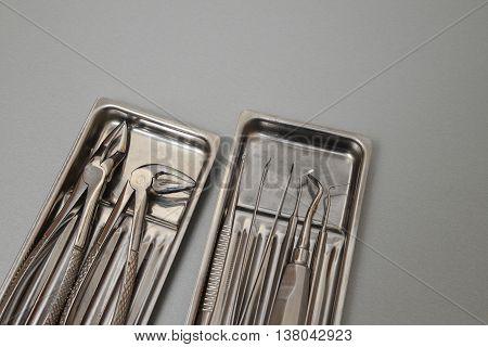 Professinal dental instruments: surgery dental set closeup.