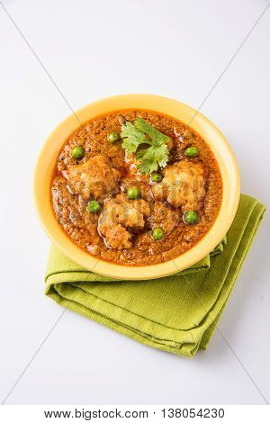 indian spicy food Gobi Masala or gobi fry or cauliflower curry with green peas, served with fool indian meal or with chapati