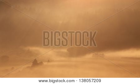 Foggy summer morning in the Alps, mountain landscape