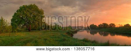 Misty morning landscape, colorful cloudy summer sky