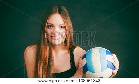 Young Woman Wear Sportswear And Hold Ball.