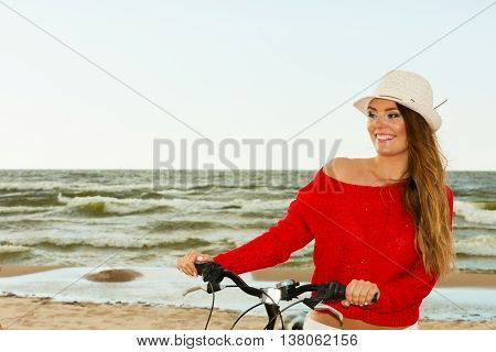 Beauty Tourist With Bike On Beach.