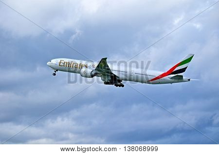 ST PETERSBURG RUSSIA - MAY 11 2016. A6-EBY Emirates Airline Boeing 777 airplane view in flight. Airplane is flying in the sky after departure from Pulkovo airport in St Petersburg