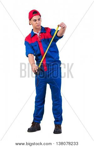 Young repairman with tape measure isolated on white