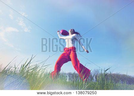 Happy girl on the grassland