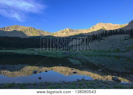 Wheeler Lake with mountain reflections in northern New Mexico.