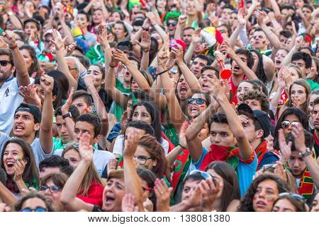 PORTO, PORTUGAL - JUL 10, 2016: Portuguese fans during translation of the football match Portugal - France final of the European championship 2016, in Liberdade Square at city center of Porto.