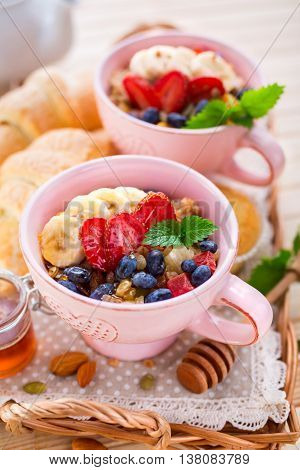 Oatmeal with bananas and berries on a breakfast table