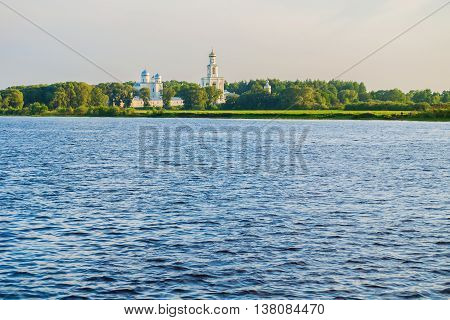 Summer architecture panorama -architecture ensemble of Yuriev monastery on the bank of Volkhov river in Veliky Novgorod Russia. Sunset summer architecture view of architecture Orthodox landmark