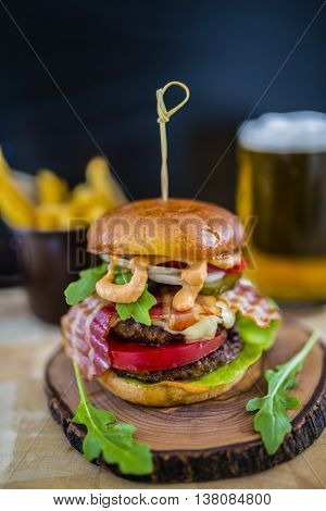 Tasty street food grilled double beef burger in crispy shortbread with lettuce and mayonnaise