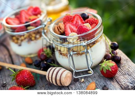 Homemade yogurt with berries in portion jars. Food for kids