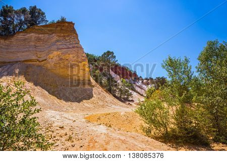 Languedoc - Roussillon, France. Orange picturesque hills. The pit on production ochre
