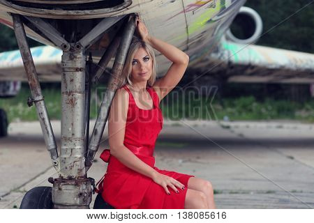 beautiful  woman and old aircraft