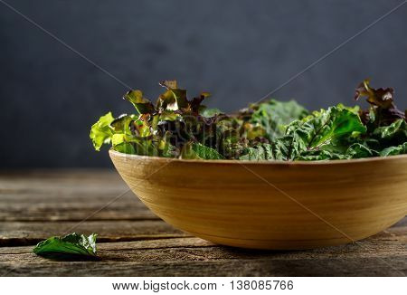 Fresh herbs for salad in the bowl. Healthy food, diet and cooking concept. Shallow depth of field