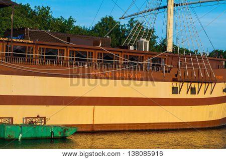 VELIKY NOVGOROD RUSSIA -MAY 29 2016. Closeup view of restaurant Frigate Flagship near the embankment at summer sunset