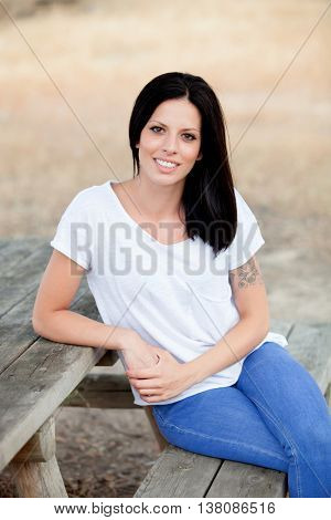 Relaxed cool girl with casual wear in a beautiful park