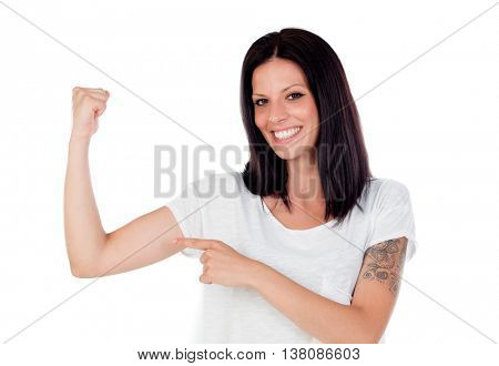 Cool brunette woman pointing her biceps isolated on white background