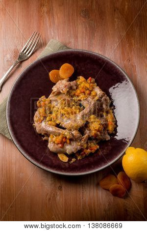roasted rabbit with vegetables and dried apricot