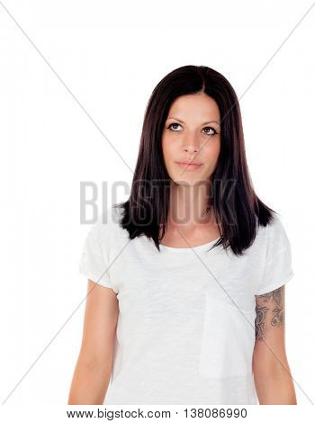Young cool brunette woman in studio white background