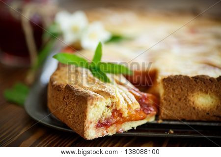 home sweet cake with fruit jam on a wooden table