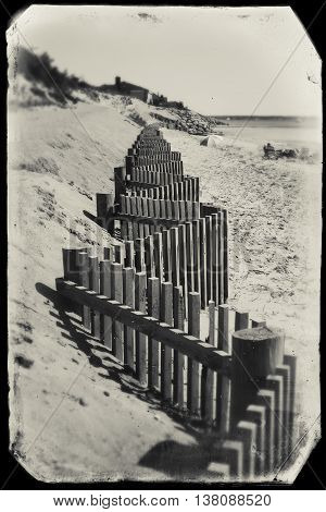 Beach fence on a beach in Eastham, MA Cape Cod, vintage look.