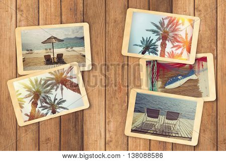 Summer holiday vacation photo album with instant photos on wooden table