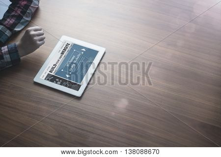 Composite image of build website interface against woman using digital tablet