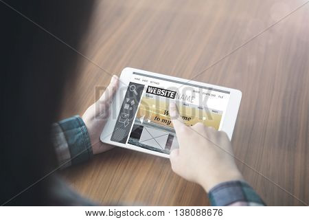 Composite image of build website interface against woman using a digital tablet