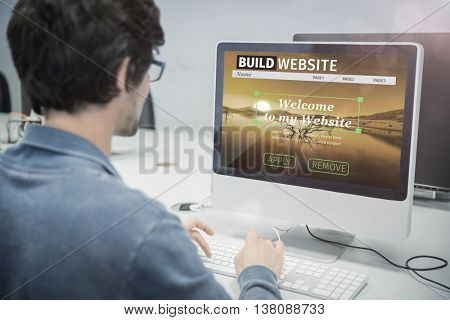 Composite image of build website interface against over the shoulder view of of serious casual man working at computer desk