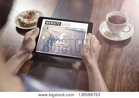 Composite image of build website interface against close-up of tablet computer