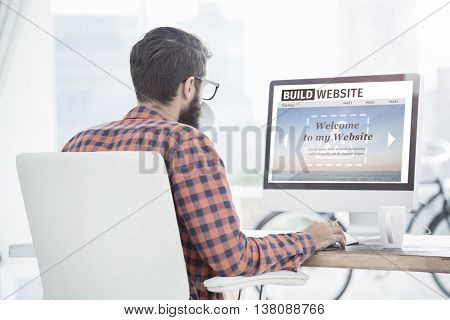 Composite image of build website interface against hipster using a computer