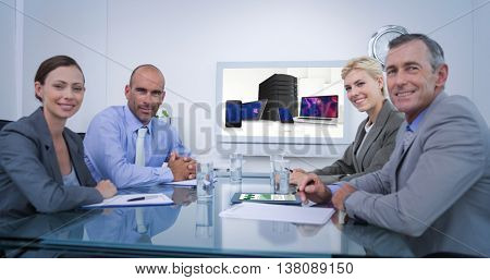 Business team looking at white screen against smartphone, tablet computer and laptop