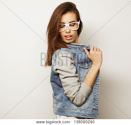 Fashion portrait of young pretty hipster woman