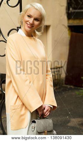 Beautiful fashionable woman on the city street.