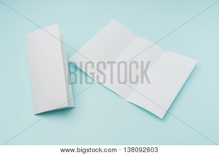 Trifold white template paper on blue background