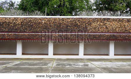 long Corridor and walkway with Layering of roof Wat Chae Haeng nan Thailand poster