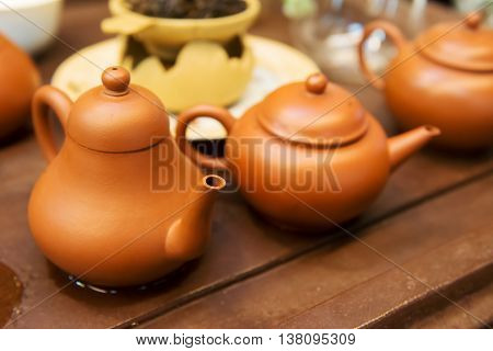 Tea pots from Yixing clay on the table